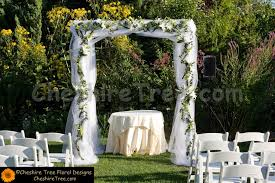 Wedding Arches Using Tulle Lang 03 Castle On Hudson Wedding Chuppah Tulle Scattered Flowers