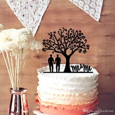 wedding cake topper together under the tree silhouette with