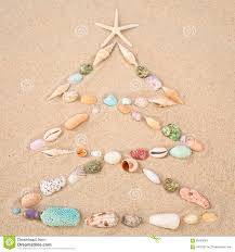 beach xmas concept christmas tree on sand made out of sea shel