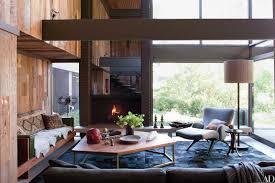 living room white sofa cushions brown wooden table pendant light