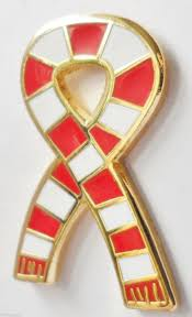 red and white scarf pin badge