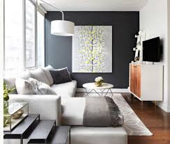 love the dark accent wall and the little pop of color in the