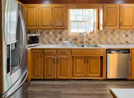 what color backsplash with honey oak cabinets kitchen cabinets painted in neutral ground painted by