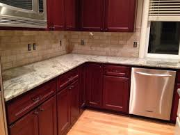 what backsplash looks with cherry cabinets backsplash help for typhoon green granite