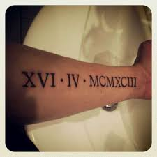 22 forearm numerals tattoos