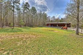 custom built log cabin with 5 stall horse barn waxhaw union
