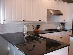 i like the white subway tile backsplash with the dark countertop