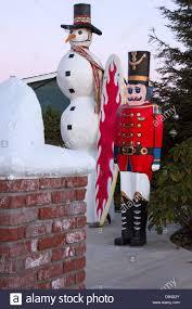 frosty snowman nutcracker roof stock photo