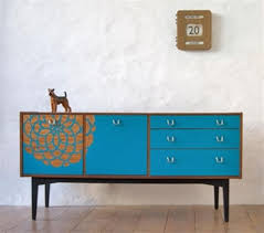beautiful mid century sideboard in blue color with flower painting