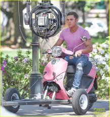 Dwayne Johnson Car Meme - zac efron dwayne johnson take a ride on a hot pink scooter on