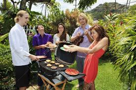 friends at a backyard bar b que in hawaii stock photo picture and