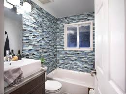 contemporary bathroom with glass tile walls a tight space also