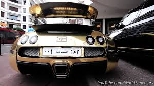 bugatti gold and gold and black bugatti veyron riding in cannes sssupersports com