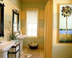 sage green and sunny yellow paint and a palm tree painting make