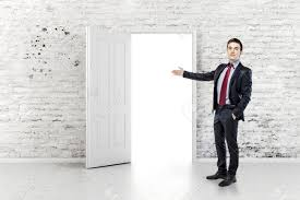 Business Front Doors by Business Man In Front Of An Open Door In A Vintage White Brick