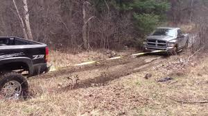 Ford Trucks Mudding Lifted - lifted gmc sierra 1500 pulling dodge 2500 cummins out of the mud