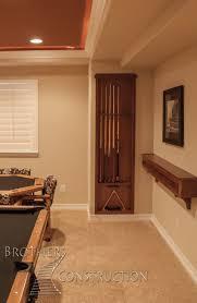 Basement Chair Rail - custom cherry pool cue rack and drink rail in basement fi