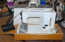 a cased electric necchi type 565 sewing machine