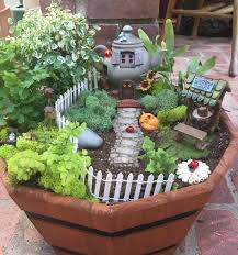 my first fairy garden it was so fun and easy collecting little