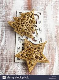 golden christmas ornaments glitter star and tree decoration on