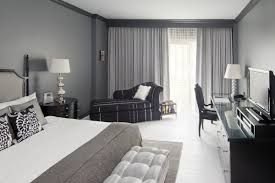 teen bedroom with black and gray color scheme also low bedding set