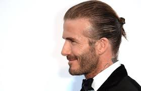 mun hairstyle david beckham is rocking the world s tiniest man bun at cannes