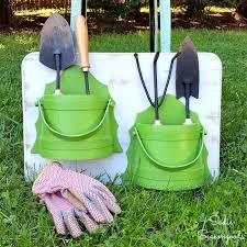 repurposed vintage bucket sconces u0026 cutting board into garden tool