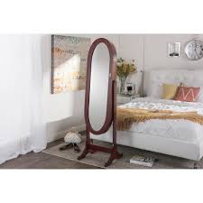 Free Standing Jewelry Armoire With Mirror Baxton Studio Apache Brown Finish Wood Oval Shaped Free Standing