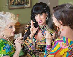 group of three 1960s style women gossiping and smoking stock photo