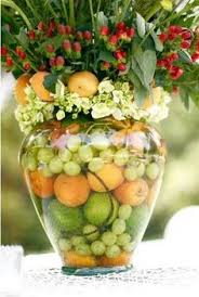fruit floral arrangements this idea of using fruit in a centerpiece for the gala plus