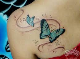 black and blue swirl butterfly on left back shoulder