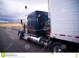 custom big rig dark blue semi truck with reefer trailer stock
