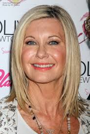 olivia newton john hairstyles olivia newton john over age 65 and wearing her hair smooth and
