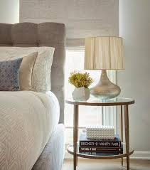 gray button tufted headboard with round clairemont round side