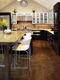 white wooden kitchen island with brown counter top and black