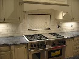 kitchen tumbled marble backsplash with multi colored glass accent