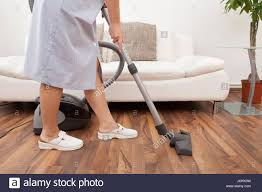 Vacuum Cleaners For Laminate Floors Young Maid Cleaning Floor With Handheld Vacuum Cleaner Stock Photo