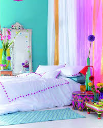 bright bedroom blue wall with colorful curtains and mirror and