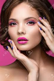 beautiful model with bright makeup and colored nail polish