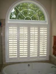 arched eyebrow windows are no problem for plantation shutters