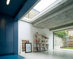 bureau de change a extension by bureau de change has blue kitchen and white lounge