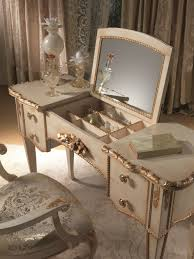 small bedroom with corner white wooden vanity dressing table with three fold corner mirror vanity