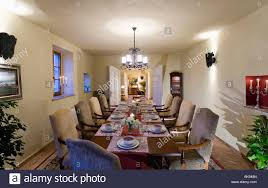 wall lights and modern chandelier above table with place settings