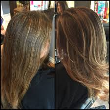 high lighted hair with gray roots from a stripy blonde highlight with grey roots to a soft balayage