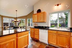 bright kitchen room with concrete floor light brown cabinets