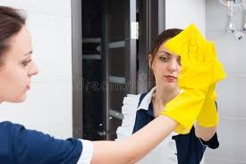 how to clean mirrors in bathroom hotel maid cleaning bathroom mirror stock photo image of hotel