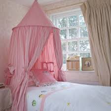 pink canopy bed for small princess bedroom ideas with beige