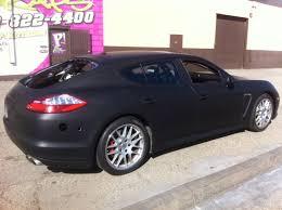 Porsche Panamera Back - matte black vinyl wrap porsche panamera for chase car inc