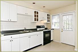 white kitchen cabinets with brown granite countertops home