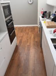 kitchen island counter stools tile floors porcelain tile flooring looks like wood counter
